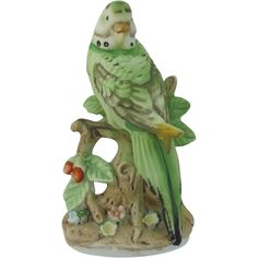 A sweet Parakeet Budgie Figurine available from Antique Beak on Ruby Lane