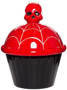 SOURPUSS CUPCAKE COOKIE JAR What a ghoulishly delicious decoy! Though it may look like your everyday giant, ceramic, red skull-topped cupcake, it's actually the perfect place to stash some sweet treats!  $28