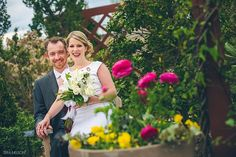 Bride and groom in the Penn State Arboretum after their wedding. Photo by State College wedding photographer, Tera Nelson. University Park, elopement, Wedding flowers, vibrant photography, red lipstick, simple bouquet.
