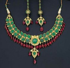 Emerald necklace with spinel fringe