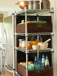 Unfitted storage units are a savvy solution for boosting your kitchen's storage real estate. This sturdy metal shelving unit, squeezed in next to the refrigerator, is outfitted with baskets to hold baking supplies and bottled drinks. Kitchen Shelves, Kitchen Pantry, New Kitchen, Kitchen Decor, Kitchen Design, Kitchen Cabinets, Open Pantry, Kitchen Hacks, Kitchen Interior