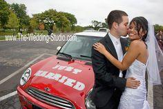 Mini Cooper got these newlyweds around on their wedding day. Super cute! www.The-Wedding-Studio.com
