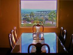 dining room in front of window with view of ocean