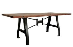 A-Leg table is a signature piece from District Eight made from hand-cast solid iron table legs from salvaged vintage machine parts combined with reclaimed timber from local markets.