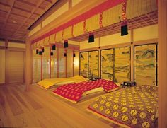 A heian room recreation with beds that have junihitoe layers as bedding.