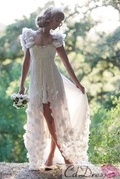 The way a dress can be long and elegant while showing just a sliver of leg. | 50 Gorgeous Wedding Dress Details That Are Utterly To Die For