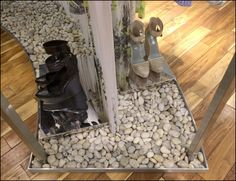 A low tray base creates containment for round, river-washed rock as both ballast and decor at BCBG®. Grey Stone, Graphic Design Inspiration, Shoe Rack, Base, River, Retail, Natural, Decor, Window Displays