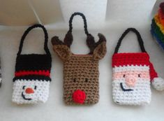 Copyright © Jessica Boyer 2012 All Rights Reserved. Pattern for 3 gift card holders you could hang in your tree for Christmas gifts. Snowman, Santa, and Reindeer. Materials: - Red Heart Super Saver – White (A) - Red Heart Super Saver – Black (B) - Red Heart Super Saver –