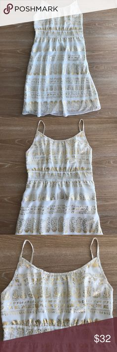"""MARK BOHO GOLD AND WHITE DRESS Condition: New in package. Size small. Zips on side. Spaghetti straps. No flaws, no rips, holes or stains. Measurements: length:34"""", bust 16.5""""(laying flat) Smoke free home/Pet hair free No trades, No returns No modeling  Shipping next day. Beautiful package! I LOVE OFFERS, offer me! ALL ITEMS ARE OWNED BY ME. NOT FROM THRIFT STORES All transactions video recorded to ensure quality.  Ask all questions before buying Mark Dresses Midi"""