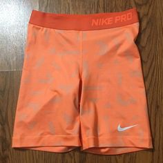 NIKE PRO ORANGE SPANDEX SHORTS Excellent condition spandex shorts by Nike! Like new condition! Longer inseam style. Super stretchy and comfortable. Nike Shorts