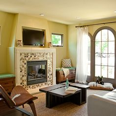 FINISHED REMODEL:  Luxury of less: Living room                                       Define small rooms with furniture that makes a statement.