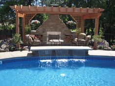 Outdoor kitchens, fireplaces, and bars offer a new useable element to any pool area (Only Alpha Pool Products)
