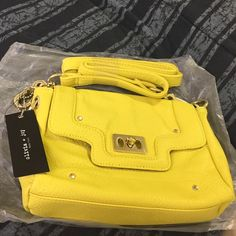 NEW Olivia + Joy crossbody purse New front opens. Back has zipper pocket. Bag measures 9 X 5 1/2. Olivia + Joy Bags Crossbody Bags