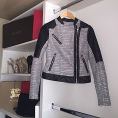 Gray/silver and black guess jacket. Gray/silver and black leather on arms zip up classy jacket Guess Jackets & Coats