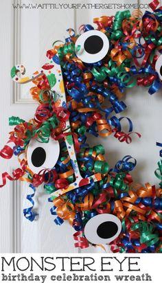 Make a fun Monster Eye Birthday Celebration Wreath to celebrate your little monster this year via www.waittilyourfathergetshome.com #birthday #birthdaywreath #monstereyes