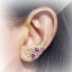 Handmade adjustable unique silver plated ear cuff. This ear cuff comes with beautiful purple glass crackle beads.  They adjust perfectly to any size ear. No need for piercing with these cuffs as they just slip on to any ear. They also come in blue or pink.  This listing is for one ear cuff. Please choose left, right or both from the menu when ordering.    See more ear cuffs in my shop. https://www.etsy.com/shop/ElectriccDreams    Thank you for visiting.