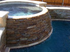 Stacked stone pool & hot tub