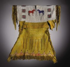 American Indian Art:War Shirts/Garments, A SOUTHERN CHEYENNE GIRL'S PICTORIAL BEADED AND FRINGED HIDE DRESS.c. 1890. ...