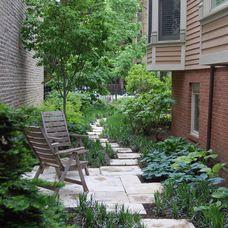 Traditional Landscape by Prassas Landscape Studio LLC good for a small side yard.  No Grass
