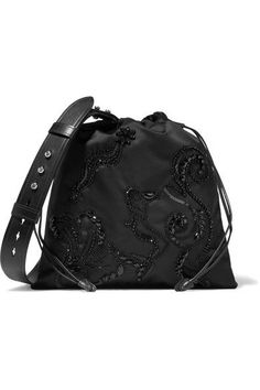 Prada's bag is intricately embroidered with scores of sequins and beads to form an eye-catching mermaid motif. It's made from the label's signature shell and trimmed with a durable leather shoulder strap that can be adjusted to suit your height.