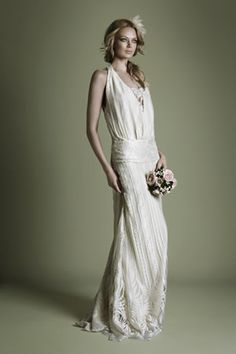 vintage style wedding dress, kinda like this, dont really know how it would look on me tho