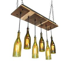 Reclaimed Wood Base- 6 Wine Bottle Pendant Chandelier The base is made of reclaimed wood and sealed with a durable matte clear coat. The upgraded cord is a black twisted rayon with gilt sockets. And a mix of six recycled wine bottle pendants. The longest bottle hangs 22 from the
