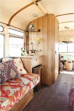 Inside vintage RV - I like the use of the bathroom wall to have the sink on it, cuts down on water lines