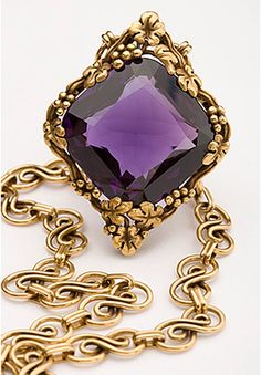 Remarkable Amethyst Necklace From Smithsonian's National Gem Collection Celebrates 100th Birthday. The square cushion-cut amethyst is delicately framed by 18-karat vines, leaves and grapes in a design conceived by Louis Comfort Tiffany in 1915. The deep purple amethyst, which displays flashes of red, is suspended as a pendant from a flowing double-figure-eight chain. The floral motif is an excellent example of Art Nouveau jewelry(1890-1919).