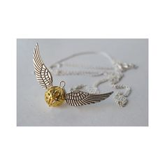 Open at the Close - Golden Snitch Necklace ($20) ❤ liked on Polyvore featuring jewelry, necklaces, harry potter, frog necklace, frog charms jewelry, frog jewelry, golden necklace and charm necklaces