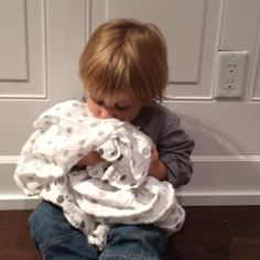Lulujo baby with cotton muslin blanket.