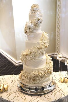 White and gold wedding cake by Cake Crown Bakery