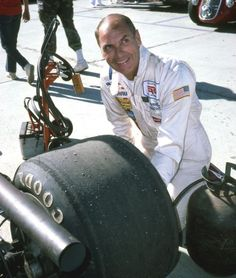 Ever the detail-man, George Follmer checking the tire on the Tyrrell-Ford before the Vintage Formula One event. Follmer led for a time when Dan Gurney passed him in the Eagle. At the end, Bob Bondurant in Don Wasserman's 1967 Formula One Ferrari passed both to take the checker. (photo credit: Art Evans Collection)