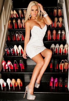 Gorgeous blonde lady in a figure hugging dress. Love the sparkly shoes and the way she's matched them with her jewellery. Plus what a fab shoe collection, and there all platform stilettos..my favourite style.