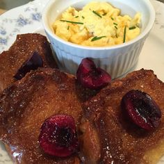 Creme Brulee French Toast (an amazing French toast flavor) with Bing cherries and scrambled eggs.