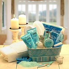 Pedicure Gift ~ gift container, terry cloth slippers,  pedicure set including toe separators, cutical cleaner, clippers and 2 files,   moisturizing foot wash, moisturizing foot lotion, soaking salts, foot spray, terry cloth bath pillow, votive holder with votive, and a toenail bristle brush & file.