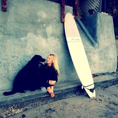 A girl, her dog, and her board