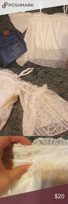 NWOT White lace festival crop Super cute! Bottom layer is cropped, top lace layer is normal length. Features adjustable spaghetti straps and off the shoulder lace sleeves. Great for summer concerts! NWOT. NEVER worn love fire Tops Crop Tops