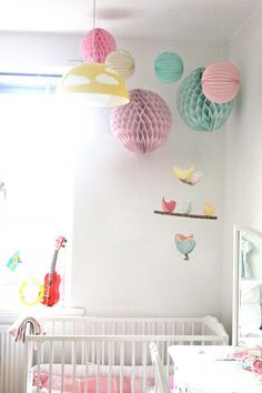 Bird Hanging Mobile - Baby Nursery Decor - 3 Handmade Birds in Teal, Yellow and Pink Cotton Fabrics. £25.00, via Etsy.