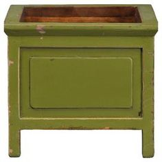 "Create a stylish floral display with this lovely pine wood planter, showcasing a square silhouette and distressed green finish.         Product: PlanterConstruction Material: PineColor: Distressed greenFeatures: HandcraftedDimensions: 7.5"" H x 8"" W x 8"" D"