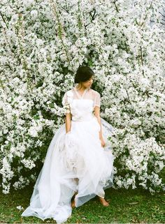 White dress and a wall of flowers