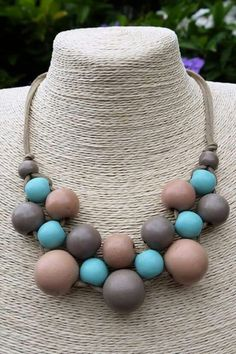 Wooden beads and leather strap necklace DIY Idea Ceramic Pendant, Ceramic Jewelry, Wooden Jewelry, Polymer Clay Jewelry, Wooden Beads, Fabric Jewelry, Beaded Jewelry, Jewelry Necklaces, Handmade Jewelry