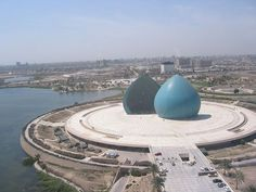 The clam shells, Al-Shaheed Monument, Martyr's Memorial for soldiers who died in Iraq-Iran war, Baghdad Iraq. Astrogeographic position: in the combination of the magnetic,royal fire sign Leo the sign of the Sun with the air sign Aquarius the sign of the sky. Aquarius stands for the monument under the open sky and sun and even opened up central dome building which has been cut into to halfs. And Aquarius is typical for a site that stretches out into water. Valid for field level 3