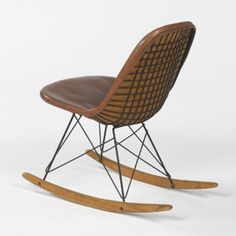 CHARLES AND RAY EAMES    rocker    Herman Miller  USA, c. 1951  plastic coated metal, birch, leather  19 w x 20 d x 30.5 h inches