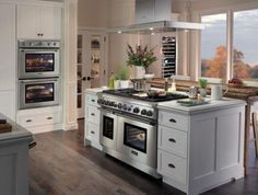 kitchen island with a cooker and an oven
