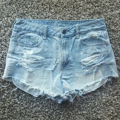American Eagle High-waisted Jean Shorts High-waisted jean shorts, lots of distressing.  Very big pockets that slightly peek out. Light wash. American Eagle Outfitters Shorts Jean Shorts