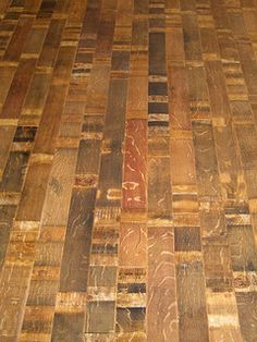 Fontenay Wine Barrel Flooring - very cool. Don't know if it would work with the look of existing plank floor in the other rooms though.