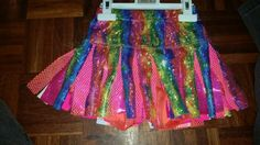 Rainbow sparkly skort with orange sparkly shorts(attached) pink sparkly strips and pink & orange mesh ;) loooks great with blue under too!