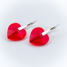 Swarovski Heart Earrings 14mm Light Siam  Dimensions: length: 2,8cm stone size: 14mm Weight ~ 4,05g ( 1 pair ) Metal : silver plated brass Stones: Swarovski Elements 6228 14mm Colour: Light Siam 1 package = 1 pair Price 17,99 PLN  ( about`4,5 EUR )