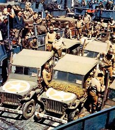 Image 1/1  Jeeps loaded on a landing craft for D-Day, 6 June 1944. Yellow interior of the star surround painted in chemical reactive paint (aka gas detecting paint.)