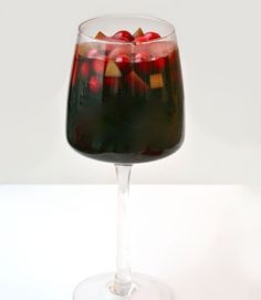 Give sangria a holiday twist by making a mulled wine studded with red and green fruit.
